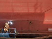 Welder in Man Lift Welding On Ship Hull Royalty Free Stock Image