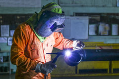 Welder man. Tig welding in piping shop Stock Photography