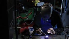 Welder man Tig welding in workshop. stock footage