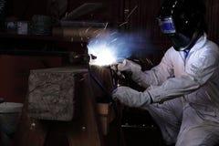 Welder man welding metal in the factory. Industrial concept. Royalty Free Stock Photos