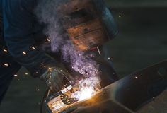 Welder man welding, spark, light and hot Stock Image