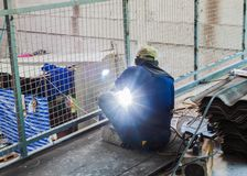 Welder man welding  steel structure wire mesh. For construction Royalty Free Stock Images