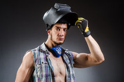 Welder with mask against Royalty Free Stock Image