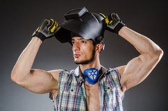 Welder with mask against. Dark background Royalty Free Stock Images