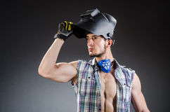 Welder with mask against Royalty Free Stock Images