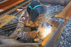 Welder in mask welding construction Stock Photo