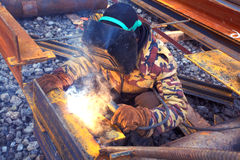 Welder in mask welding construction Stock Images
