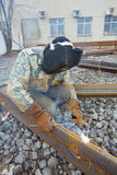 Welder in mask welding construction Royalty Free Stock Photos