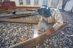 Welder in mask welding construction Stock Photos
