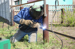 Welder outdoor. Working and soldering iron with mask Stock Images