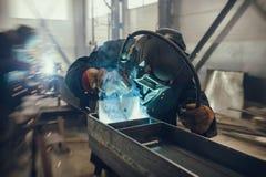 Welder performs welding work of metal structures royalty free stock image