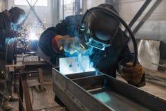 Welder performs welding work of metal structures royalty free stock photos