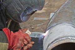 Welder performs welding works on pipelines Stock Photos