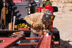 Welder-3. Photo of welder frabricating and welding a piece of steel Stock Image