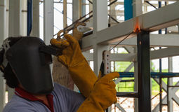 Welder in position over head action. Stock Photography