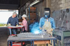 Welder with protective clothing Stock Image