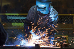 Welder with protective equipment in factory Royalty Free Stock Photography