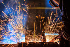Welder with protective equipment in factory Stock Images