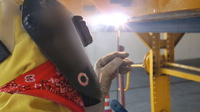 Welder with protective equipment stock video footage