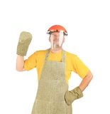Welder with protective face shield and apron. Stock Photo