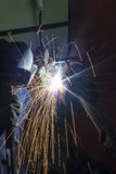 Welder with protective mask doing welding Royalty Free Stock Photography