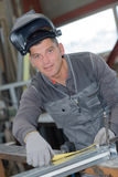 Welder in protective mask looking at camera Royalty Free Stock Photo