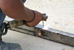 Welder with protective mask welding metal Stock Photos