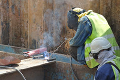 Welder with protective mask welding metal Royalty Free Stock Photography