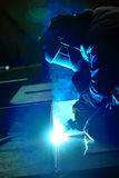 Welder with protective mask welding metal Royalty Free Stock Image