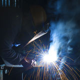 Welder with protective mask Stock Images