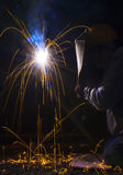 Welder with protective mask welding Stock Image