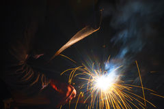 Welder with protective mask welding Stock Photos