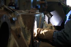 Welder repair bore by shield metal arc welding. Process Stock Image