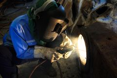 Welder repair bore by shield metal arc welding Stock Photography