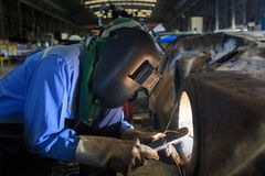 Welder repair bore by shield metal arc welding. Process Stock Photo