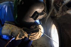 Welder repair bore by shield metal arc welding. Process Royalty Free Stock Images