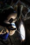 Welder repair bore by shield metal arc welding. Process Royalty Free Stock Photo