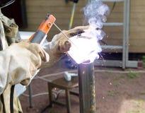 Welder, repairing the gardening equipment Royalty Free Stock Photography