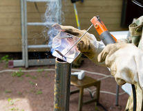 Welder, repairing the gardening equipment Royalty Free Stock Images