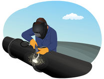 Welder. Is repairing a pipeline section. Heavy industry Royalty Free Stock Photography