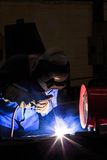 Welder repairing surface by shield metal arc welding. Shield metal arc welding process is most popular in manufacture Royalty Free Stock Photos