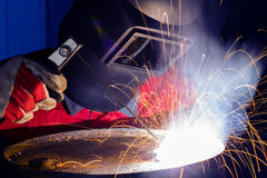 Welder in safety mask Stock Photos