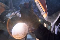 Welder in the shop weld sample from the tube for passing of cert Royalty Free Stock Photography