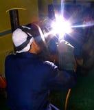 Welder on site. Welders using welding machines to work Stock Photography