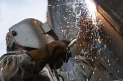 Welder smoke. A metal welder busy at work Stock Photos