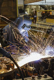 Welder with sparks in Industrial Royalty Free Stock Image