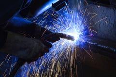 Welder steel structure in workshop. Factory Stock Photos