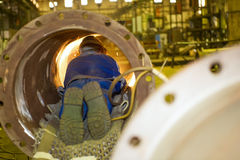 Welder in a tube Royalty Free Stock Images