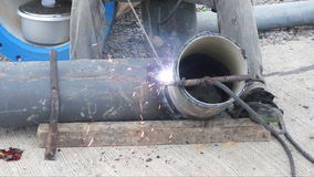 Welder uses torch for welding pipe metal on site. stock video footage