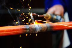 Welder using torch on metal Royalty Free Stock Photos